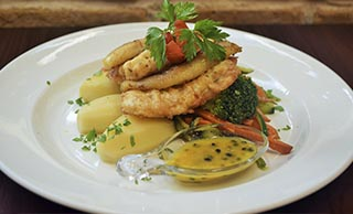 Sword fillet with banana and passion fruit sauce
